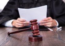 Judge Holding Documents